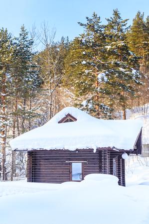 gutter: Wooden hut in the snow. Belokurikha, Altai, Russia Stock Photo