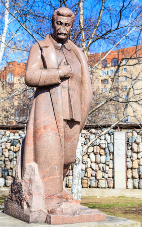 Monument to Joseph Stalin against the background of the sculptural composition Victims of repression in the park Museon. Moscow, Russia
