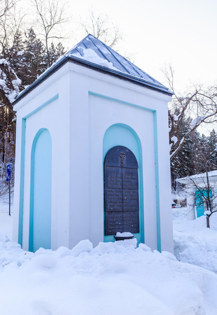 Memorial sign in the form of a small chapel Serpentine well.  Resort Belokurikha. Altai, Russia