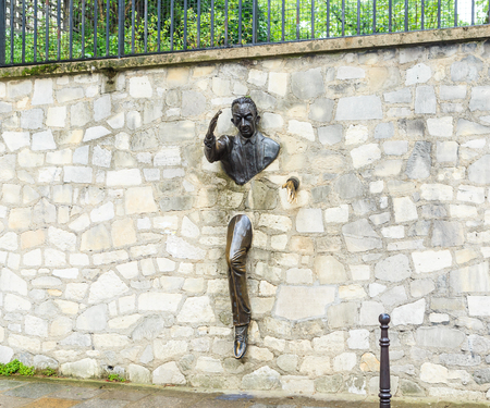 Jean Marais sculpture Le Passe-Muraille (Man Who Walked through Walls, 1989) on Montmartre. Le Passe-Muraille is the title of a story by Marcel Ayme.