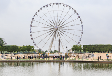 spokes: Parisians and Tourist in famous Tuileries garden. Tuileries Garden (Jardin des Tuileries) is a public garden located between Louvre Museum and Place de la Concorde.