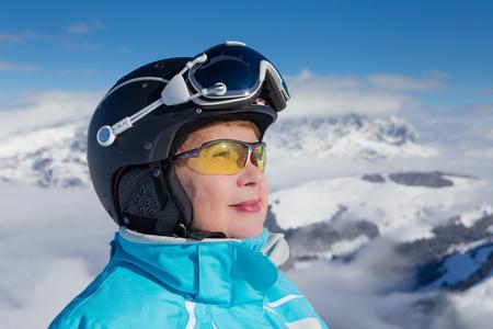 Portrait skier mountains in the background. Ski resort  Soll, Tyrol, Austria photo