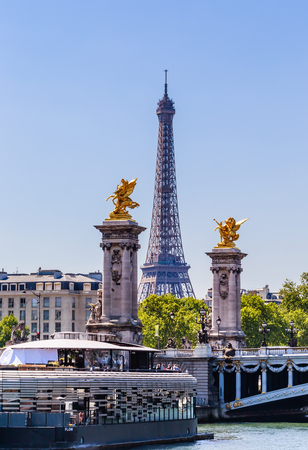 Fragment of the Alexander III Bridge across the Seine. Eiffel Tower.  Paris, France. View from the water