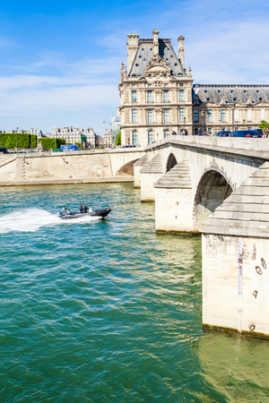 French water policemen in a speed boat on the river Seine  near Flora Pavilion ot the Louvre and Pont Royal. Paris. France