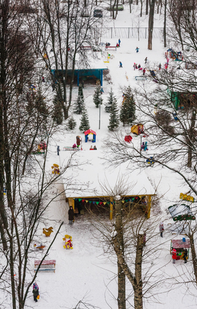 Children in the playground in the kindergarten in the winter. Moscow, Russia
