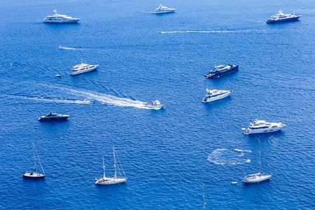 Blue sea and leisure boats seen from  from Augustus Gardens,Isle of Capri, Italy Stock Photo