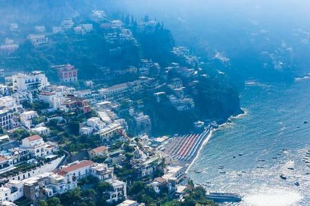 View of Positano town at Amalfi coastline. Colorful houses along the sea coast, Italy