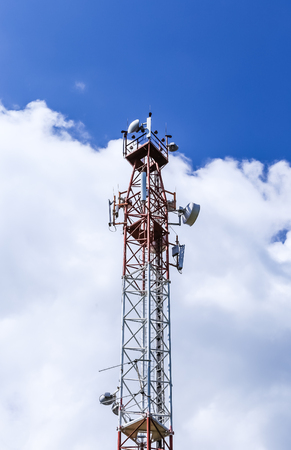 Communications tower  complete with various antennas and microwave and satellite dishes Stock Photo