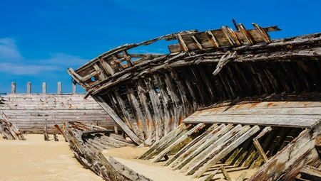 Shipwreck cemetery at the river Etel in Brittany. Magouer - Le Cimetiere de bateaux. France Stock Photo