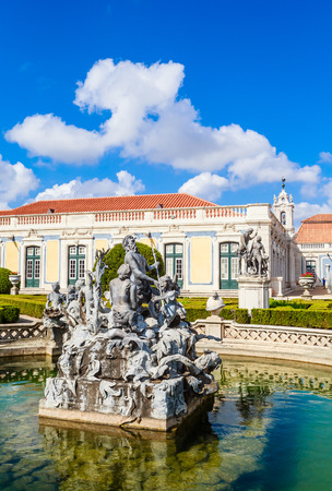 The National Palace of Queluz - Lisbon - Portugal. Neptunes Fountain and the Ceremonial Facade of the Corps de Logis designed by Oliveira
