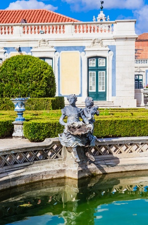 The National Palace of Queluz - Lisbon - Portugal. Fragment of Neptunes Fountain and the Ceremonial Facade of the Corps de Logis designed by Oliveira Redactioneel