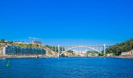 Arrabida Bridge in Porto Portugal, crossing the Douro River and linking Porto with Vila Nova de Gaia