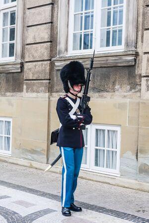 The guards of honour in  uniform guarding the Royal residence Amalienborg Palace.   Copenhagen. Denmark