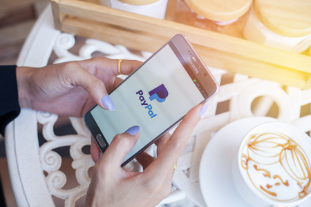 paypal: Bangkok, Thailand - February 12,2017:Using PayPal on iPhone. PayPal is a worldwide online payment system and one of the most popular ways of making payment on the Internet.