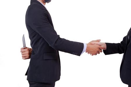 Stab back,two business men making a deal but hiding knives Foto de archivo