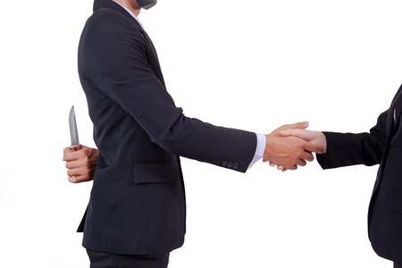 Stab back,two business men making a deal but hiding knives Stockfoto