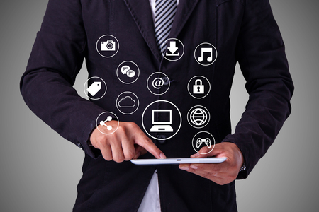connection connections: Business man Hand touching  tablet pc, social media concept Stock Photo
