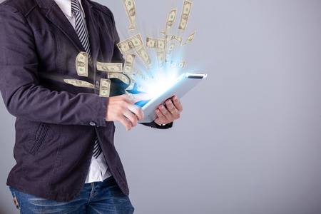 business man using a laptop building online business making money dollar bills