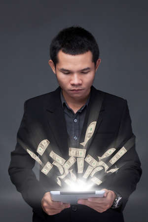 device: business man a laptop online business making money dollar bills