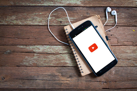 BANGKOK,THAILAND - March 28,2016: Smartphone with YouTube app on the screen  YouTube is the popular online video-sharing website, founded in February 14, 2005