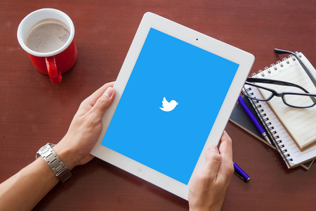 bangkok, thailand - June 17.2016: Twitter logo on the screen. Twitter is a social media online service for microblogging and networking communication.