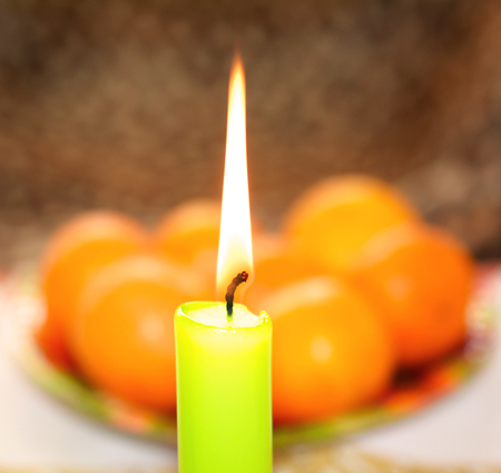 Candle and fruits for celebration