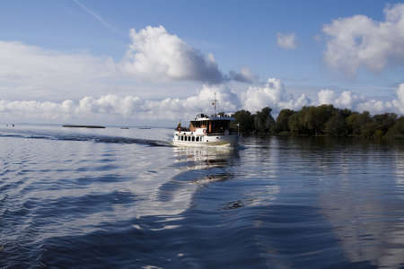 River boat in Nemunas at sunny autumn day. Lithuania Stock Photo