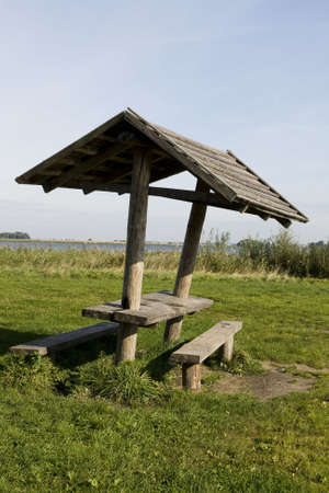 bower: Wooden bower sits empty on a sunny spring day