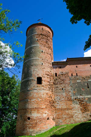 Tower of castle Panemune against blue sky photo