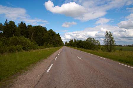 seemingly: Road, freeway seemingly disappearing into the horizon. Sunny summer day. Transportation, travel concept Stock Photo