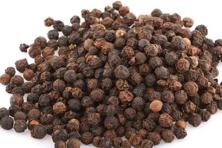 preperation: Black Peppercorn seeds on white Stock Photo