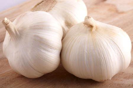 Bulbs of Garlic on ash table