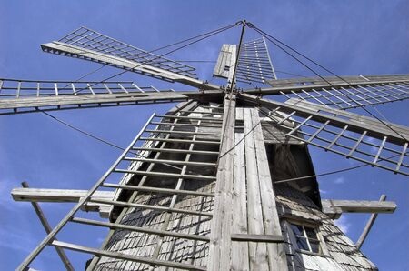 Windmill against the dark blue sky. Stock Photo