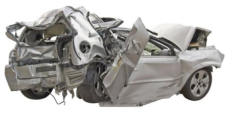 A wrecked passenger car on a white background.