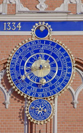 The big clock-calendar on the Blackheads house in Riga. photo