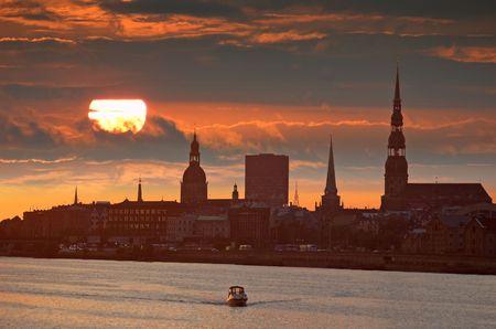 Rising over the river Daugava in Riga, Latvia. Stock Photo