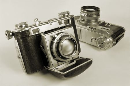 antiquarian: Two antiquarian 35-mm film cameras with put-forward lens. Stock Photo
