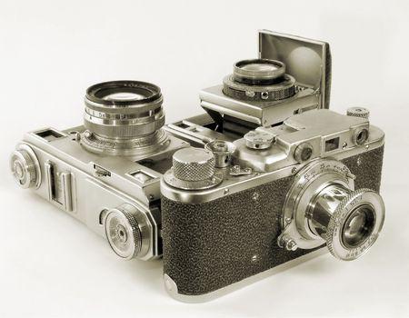 antiquarian: Three antiquarian 35-mm film cameras with put-forward lens.
