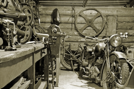 Two motorcycles and tools in old garage. Stock Photo