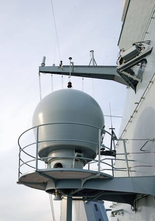 The artillery radar on-board a frigate. photo