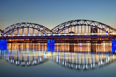The morning express train on the bridge across Daugava river.