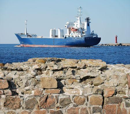 seacoast: The cargo ship leaves Riga port. Stock Photo