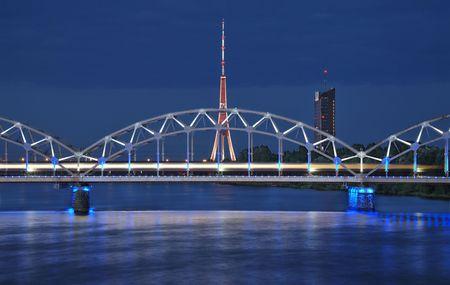 The night express train on the bridge across Daugava river.
