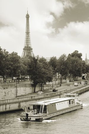 Quay of the Seine river and Eiffel tower in Paris, France.