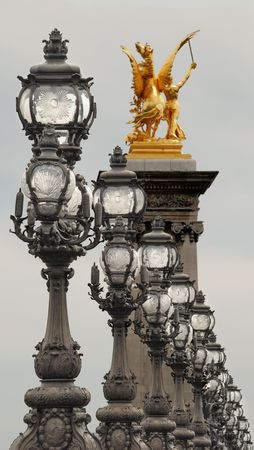 the architecture is ancient: Candlesticks and statue on Bridge Alexander III in Paris, France. Stock Photo