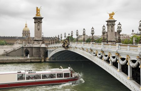 invalides: The Alexander III Bridge across Seine river and Les Invalides in Paris, France.