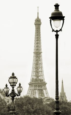 greatness: Street lanterns on the Alexandre III Bridge against the Eiffel Tower in Paris, France.