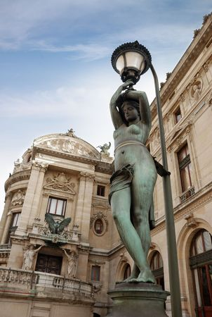 Lamppost near to National musical academy and Paris Opera Garnier, France. photo