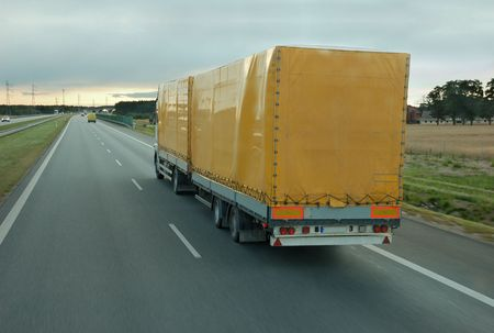 Freight truck with container on the high-speed road. Stock Photo - 5862448