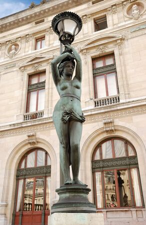Lamppost near to National musical academy and Paris Opera Garnier, France. photo